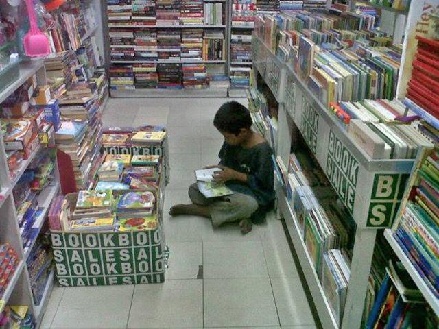 barefoot kid reading