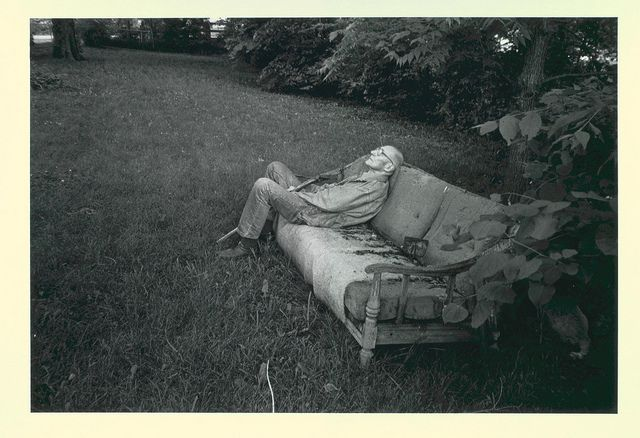 William Burroughs sitting on sofa