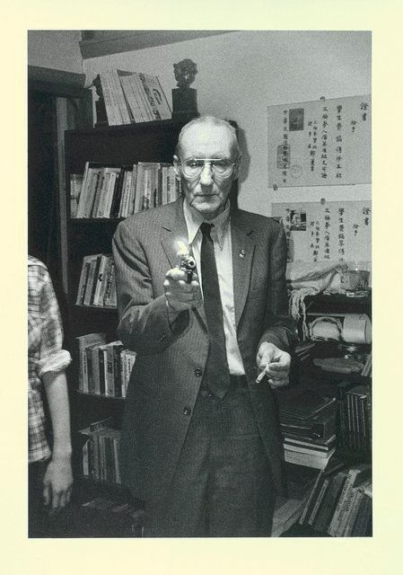 William Burroughs with lighter and cigarette